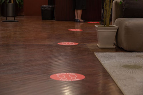 Socially distanced floor signs