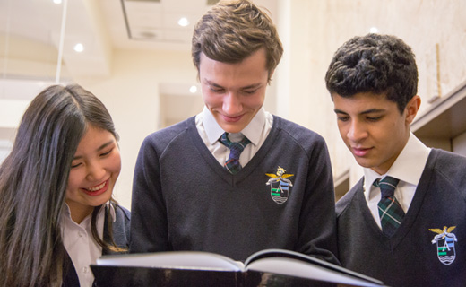 Alexander Academy Students reading a book together