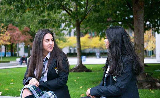 Students chatting outside of campus