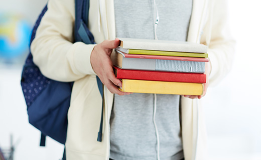 Highschool student carrying books