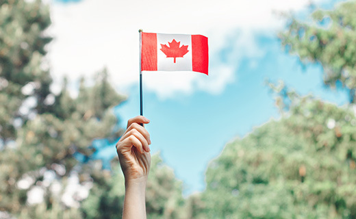 Student holding a Canadian flag