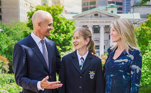 Students chatting with her parents