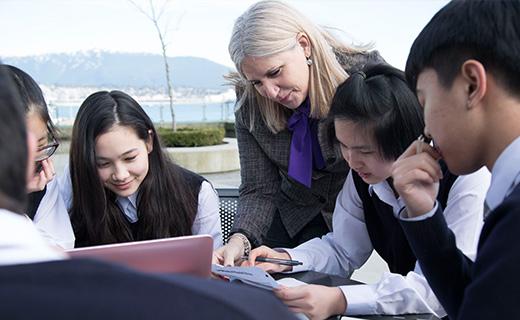 Alexander Academy students with teacher