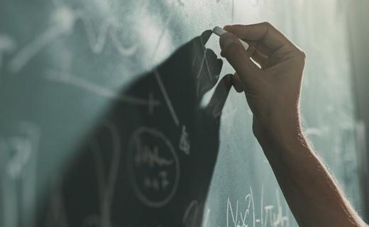 Alexander Academy writing on blackboard